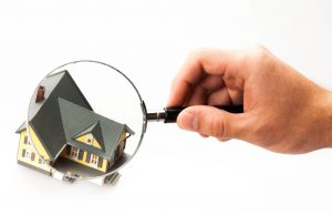 picture of a house under magnifying glass